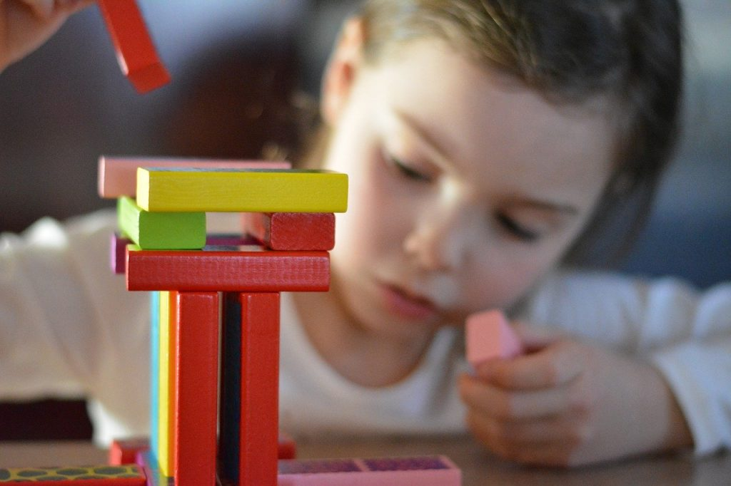 Open-ended toys like building blocks allow your child to develop creativity and help her become a better learner